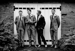 Groom and Groomsmen in Front of a Door
