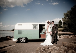 Bride and Groom Next to a Van