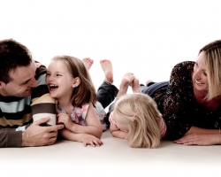 Photograph of a Family Lying Down
